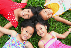Fun in the park!. Four children having good time in the park Royalty Free Stock Images