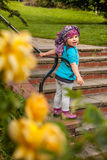 Fun in the park. Portrait of a little girl having fun in the park in spring Royalty Free Stock Photo