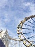 Fun park. Roller Coaster and Ferris wheel Royalty Free Stock Photos