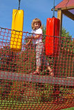 Fun in the park rope. Girl overcomes obstacles Stock Images