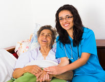 Fun with Patients. Caring nurse having fun with kind elderly patient Royalty Free Stock Images