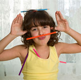 Fun with pencils. Little girl fooling around with colored pencils stock photos