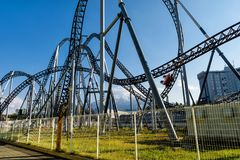 Fun people on Roller coaster with mount Fuji. Fujiyoshida, Yamanashi, Japan - May 01, 2017: Unidentified fun people riding car on Roller coaster railway with Royalty Free Stock Photos