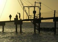 Fun on a Pier. The Barbadian boys having fun on a pier during the sunset on Carlisle Bay in Bridgetown Royalty Free Stock Photos