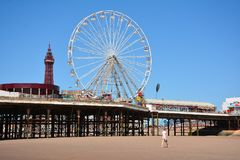 Fun pier in the Blackpool wiew of the beach backgroud of the tower. This photo was taken in the city Blackpool in July 2017 Royalty Free Stock Images