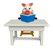 Fun  Pig cartoon character with books ;table and chair Stock Photos