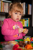 Fun with play dough. Little girl creating things from the colourful play dough at home Royalty Free Stock Photography