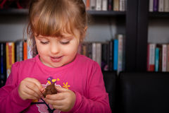 Fun with play dough. Little girl creating things from the colourful play dough at home Stock Image