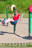 Fun on playground swing Royalty Free Stock Photo