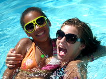 Fun in the Pool. A picture of two teenage girls having fun in the swimming pool Royalty Free Stock Photography