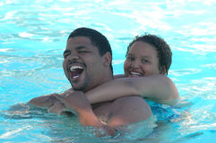 Fun in the Pool. Father and daughter playing in the pool Royalty Free Stock Image