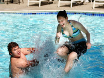 Fun in the pool. 2 kids having good time in the swimming pool Royalty Free Stock Images