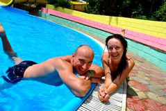 Fun in the pool. Happy couple in the pool Royalty Free Stock Photo