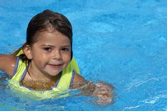 Fun in a pool. A young girl playing in pool royalty free stock image