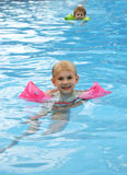 Fun in the Pool. A little girl and her brother enjoy the pool on a hot summer day Royalty Free Stock Images