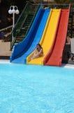Fun on pool slide Stock Photo