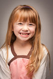Fun Portrait of an Adorable Red Haired Girl on Grey Stock Images