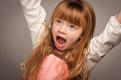 Fun Portrait of an Adorable Red Haired Girl on Grey Royalty Free Stock Photo