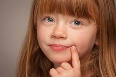 Fun Portrait of an Adorable Red Haired Girl on Grey stock photography
