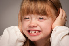 Fun Portrait of an Adorable Red Haired Girl on Grey Royalty Free Stock Image