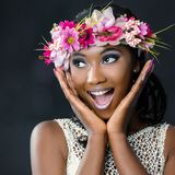 Fun portrait of attractive african bride with flower garland. Stock Photography