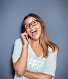 Fun portrait of a laughing woman on a mobile royalty free stock photography