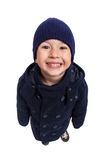 Fun portrait of smiling boy wit hat and winter coat, isolated. High angle perspective Stock Image