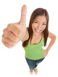 Fun portrait of a woman giving a thumbs up Royalty Free Stock Images