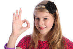 Fun positive okay hand sign by happy school girl. Fun positive okay hand sign by pretty caucasian school girl with happy smile, wearing pink t-shirt with black Stock Images