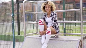 Fun pretty young woman posing on a skateboard stock video footage