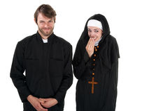 Fun Priest and Nun. A young Catholic priest and nun on white background giggling Royalty Free Stock Photography