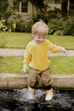 Fun in the puddle Royalty Free Stock Photos