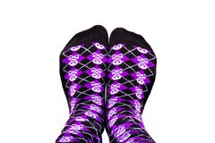 Silly socks with skulls. Fun purple and black socks with skulls on  white background Royalty Free Stock Photography