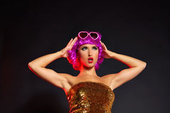 Fun purple wig girl dancing with heart glasses Stock Photos