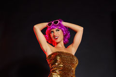 Fun purple wig girl dancing with heart glasses Royalty Free Stock Image