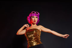 Fun purple wig girl dancing with heart glasses Royalty Free Stock Images