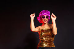 Fun purple wig girl dancing with heart glasses Stock Photos
