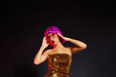 Fun purple wig girl dancing party with red glasses Royalty Free Stock Image