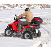 Fun with quad in snow Stock Photos