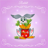 Fun rabbit boy with carrots on a purple background Stock Photo