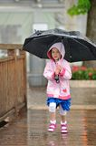 Fun in the Rain. A little girl having fun out in the rain stock images