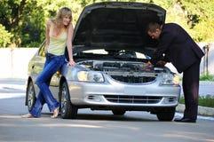 Fun repair of the broken car Stock Photography