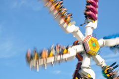 Fun Ride at a fairgound. Very fast fun ride at a fairground in summer stock images