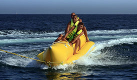 Fun riding banana boat. stock photos
