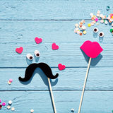 Fun romantic couple from photo booth accessories Royalty Free Stock Photos