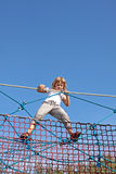 Fun on the ropes. The girl in the park performs risky stunts rope on the ropes Stock Photography