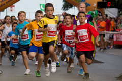Fun Run. VALENCIA, SPAIN - SEPTEMBER 1: Children compete in the XXVI Volta a Peu Fun Run in the Spanish town of Quart de Poblet near Valencia, Spain on September Stock Images