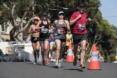 Fun run. Men and woman compete in charity fun-run stock photos