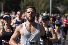 Fun run. Men and woman compete in charity fun-run royalty free stock photo