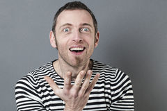 Fun 40s man expressing amazement Royalty Free Stock Photos